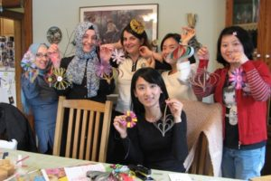 A 2015 Conversation and Crafts Group gathers to showcase their artwork.