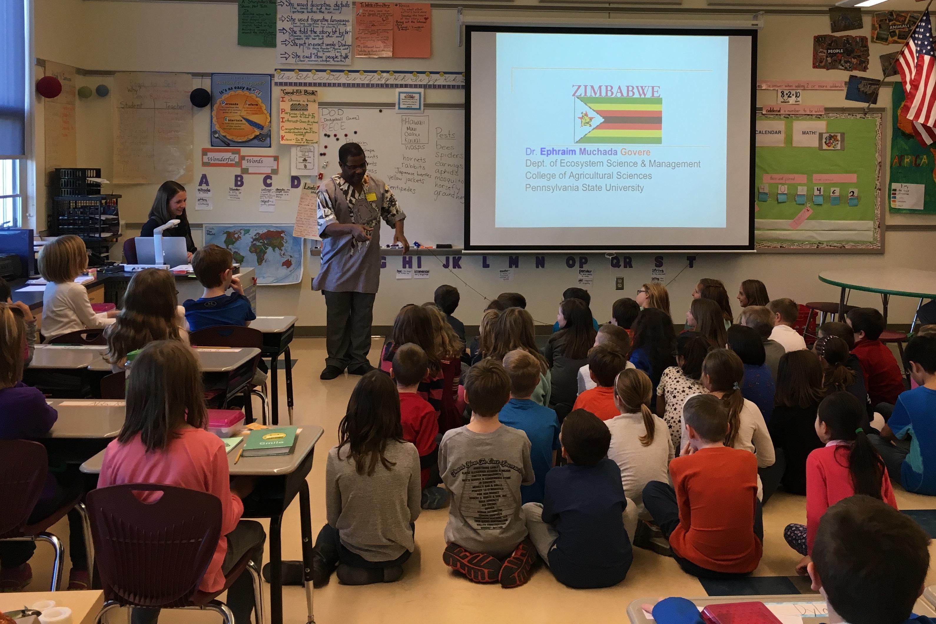 Ephraim from Zimbabwe with students